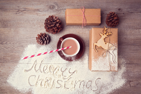 milk chocolate: Merry Christmas creative still life with gift boxes and cup of chocolate. View from above Stock Photo