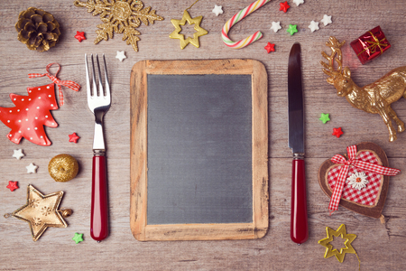 Christmas menu background with chalkboard and decorations. View from above
