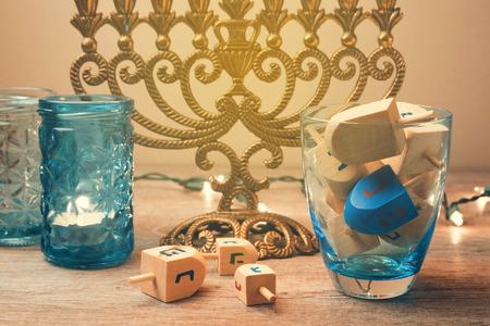 spinning top: Jewish holiday Hanukkah celebration with spinning top dreidel.  Retro filter effect.