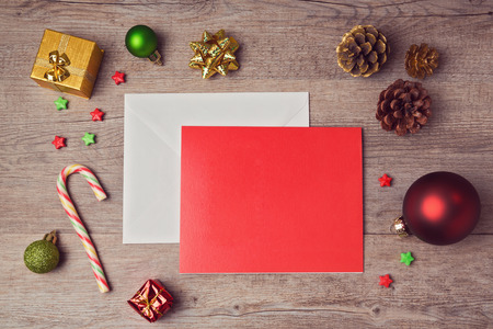christmas backdrop: Greeting card mock up template with Christmas decorations on wooden background. View from above