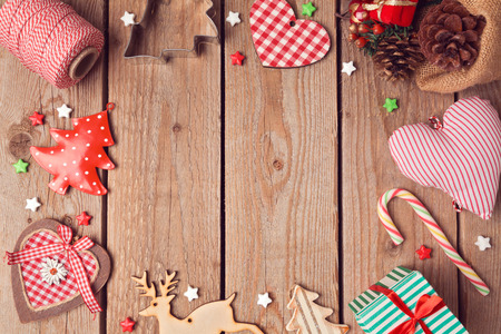 Christmas background with rustic Christmas decorations on wooden table. View from above
