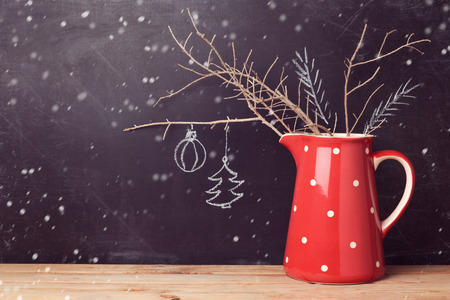 christmas backdrop: Christmas background with jug over chalkboard. Creative Christmas decorations. Alternative Christmas tree.