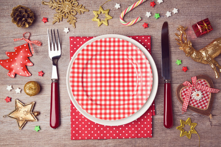 menu restaurant: Christmas dinner plate setting with rustic decorations. View from above