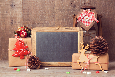 Chalkboard mock up with Christmas gifts and rustic decorations 免版税图像