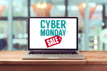Cyber Monday sign on laptop computer. Holiday online shopping concept. View from above
