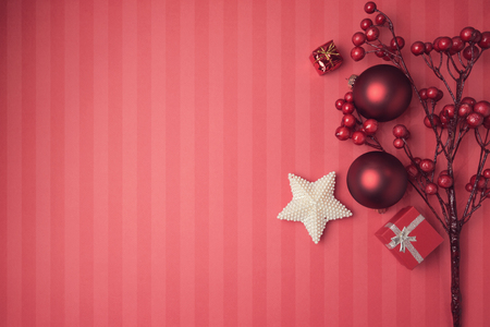 header: Christmas background with red decorations and ornaments. View from above with copy space
