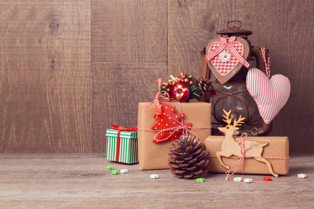 country christmas: Christmas handmade gifts and vintage lantern over wooden background Stock Photo