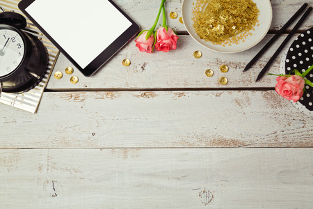 feminine: Website header design with digital tablet and rose flowers on wooden table. View from above Stock Photo