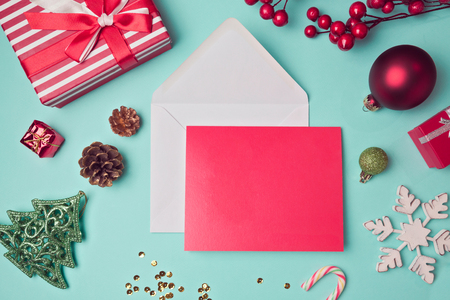 letter envelope: Greeting card mock up template with Christmas decorations. View from above