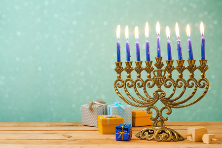 Hanukkah celebration with menorah on wooden table over bokeh background Banco de Imagens