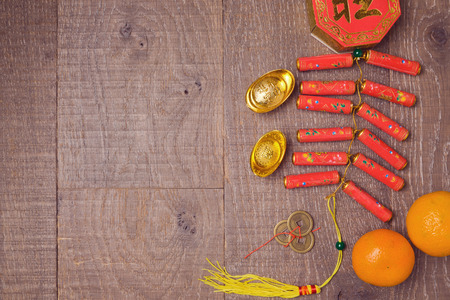 Chinese New Year decorations on wooden table  background. View from above with copy space