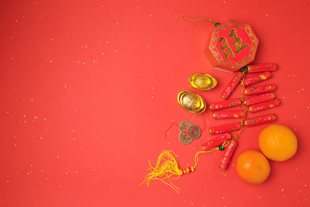 Chinese New Year decorations on red background. View from above with copy space