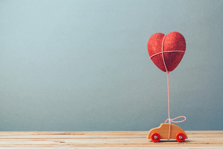 Valentines day holiday celebration with toy car and heart shape Reklamní fotografie