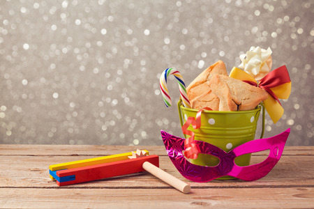 hamantaschen: Purim carnival celebration with hamantaschen cookies and grogger noise maker