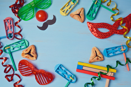 hamantaschen: Purim background with carnival mask, party costume and  hamantaschen cookies. View from above Stock Photo