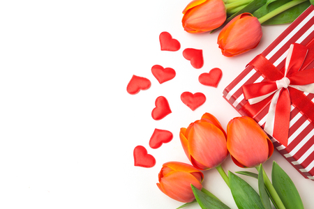 valentines background: Valentines day background with tulip flowers and gift box on white Stock Photo