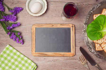 glass table: Passover (pesah) holiday celebration with chalkboad and seder plate. View from above Stock Photo