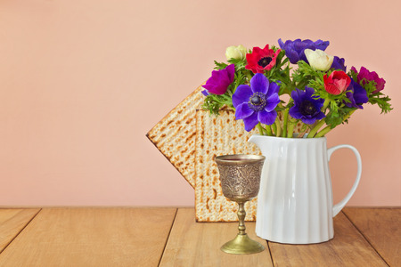 jewish food: Jewish holiday Passover background with matzoh and spring flowers Stock Photo