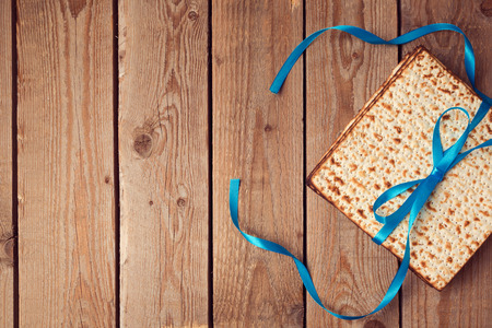matzoh: Matzoh for jewish holiday Passover (pesah) on wooden background. View from above