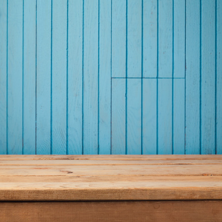 wood board: Empty rustic table over blue wooden wall background Stock Photo