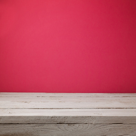painted wood: Empty wooden white table over pink wallpaper background