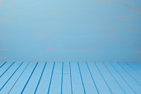 blue wall: Empty wooden blue table over blue wall. Kitchen background