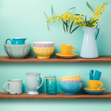 dish: Kitchen shelfs with cups and dishes Stock Photo