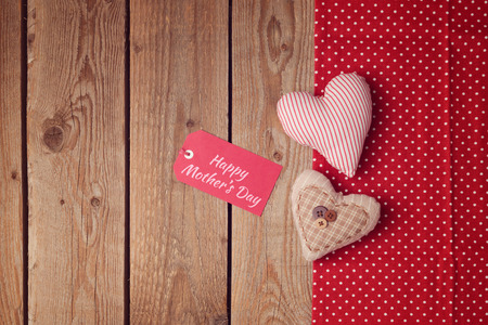 sew tags: Happy Mothers day background with heart shapes and note Stock Photo