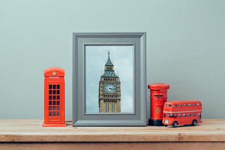 souvenir: Poster mock up template with London telephone booth and Big Ben Tower. Travel and tourism concept. Stock Photo