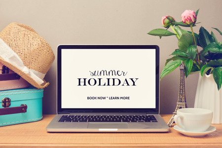 Laptop computer mock up template. Planning summer holiday vacation concept. Stock Photo