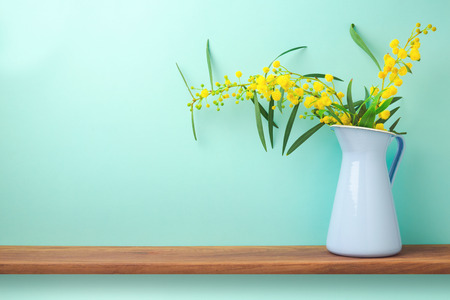 home life: Flowers in vase on wooden shelf with copy space