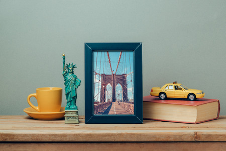 souvenir: Travel to New York, USA concept with poster mock up template and souvenirs on wooden table