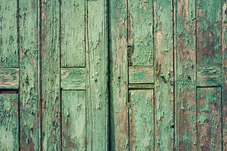 green door: Wooden rustic background with old green planks. Vintage door detail Stock Photo