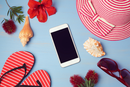 lay: Smartphone mock up template with summer beach items and tropical flowers. View from above. Flat lay Stock Photo