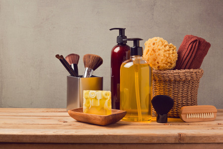 Body care products on wooden table over gray background Stockfoto