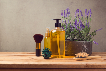 Body care products on wooden table Foto de archivo