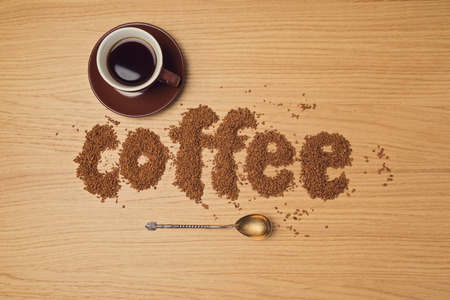 instant coffee: Coffee background with coffee cup and instant coffee letters. View from above