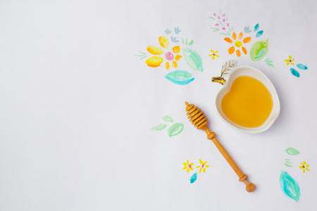 hashana: Jewish holiday Rosh Hashana background with honey and watercolor drawings. View from above. Flat lay