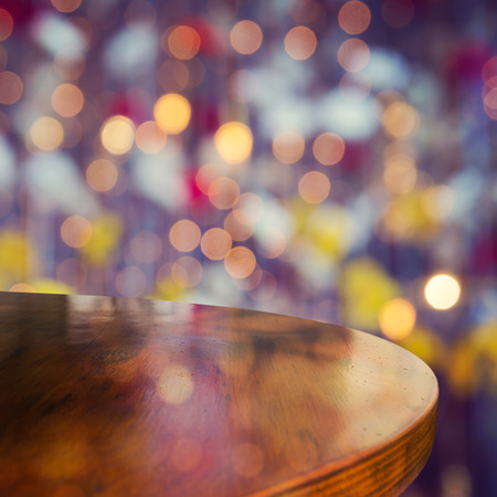 Empty wooden round table over bokeh lights beautiful background for product montage display Stock Photo