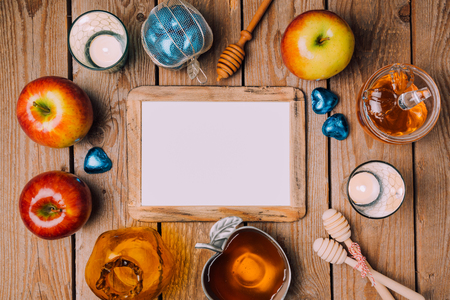rosh hashana: Jewish holiday Rosh Hashana poster mock up template with  honey and apples on wooden table. View from above. Flat lay
