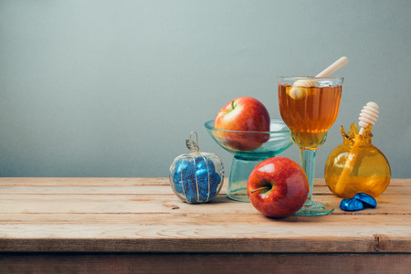 hashana: Jewish holiday Rosh Hashana celebration with honey, apples and chocolate on wooden table