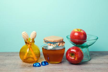 rosh hashana: Honey jar, apples and pomegranate vase on wooden table. Jewish holiday Rosh Hashana celebration background