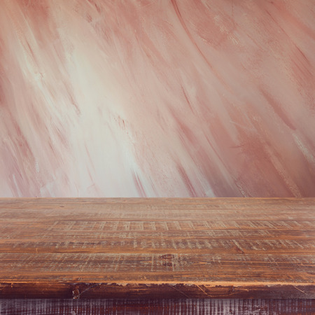 wooden color: Empty wooden table over painted marsala color wall background