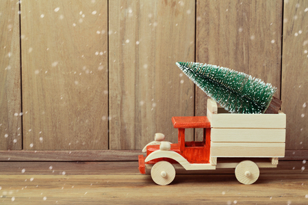 Christmas tree on toy truck car. Christmas holiday celebration concept