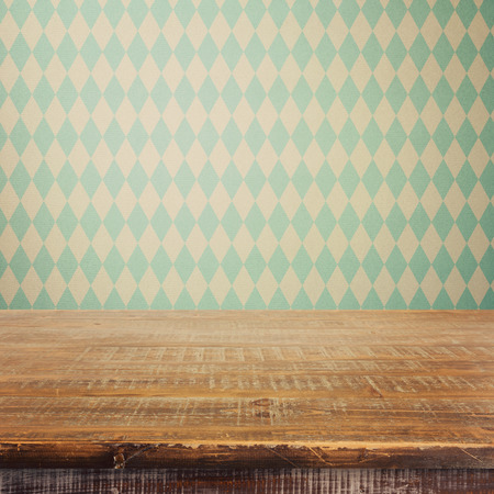 backgraound: Empty wooden rustic table over bavarian pattern wallpaper. Oktoberfest beer festival concept