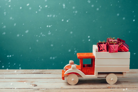 Christmas gift boxes in wooden toy truck 스톡 콘텐츠