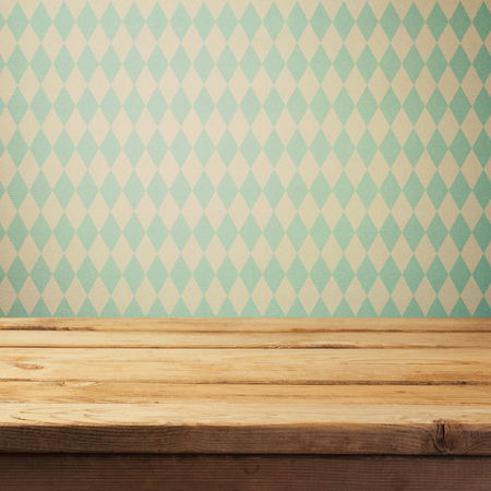 backgraound: Empty wooden deck table over bavarian pattern wallpaper. Oktoberfest beer festival concept