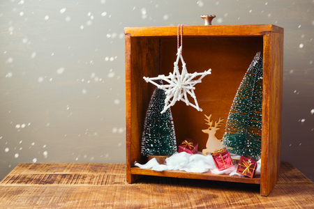 diorama: Christmas diorama with pine trees and decorations on wooden table Stock Photo