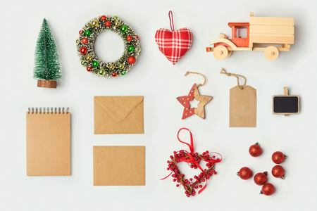 Christmas decorations and objects for mock up template design. Notebook, toy truck and wreath. View from above. Flat lay