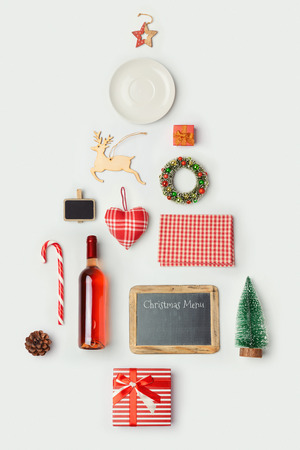 christmas objects: Christmas dinner objects organized as christmas tree for mock up template design. View from above. Flat lay